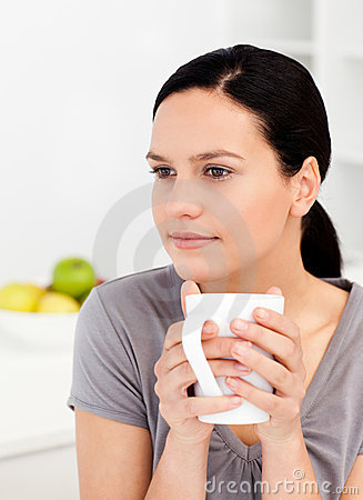 Free Quiet Woman Drinking Her Coffee In The Kitchen Stock Images - 17376354