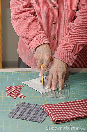 Quilter cutting fabric
