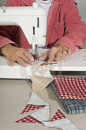 Quilter sewing pieces of fabric.