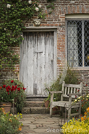 Free Quintessential Old English Country Garden Image Of Wooden Chair Royalty Free Stock Photos - 96975198