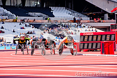 Race of athletes on wheelchairs Editorial Stock Image