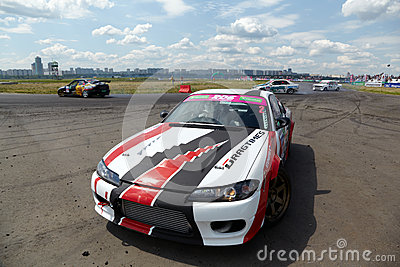 Race-car with pilot Stepanyan stands little aside Editorial Stock Photo