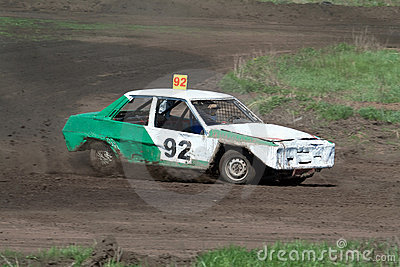 Race for survival. Green white car Editorial Stock Image
