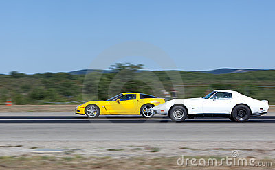 Race between two sportcars in a straight line