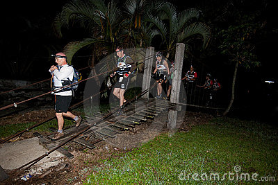 Racers crosses the river at starting point. Editorial Stock Image