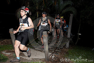 Racers crosses the river at starting point. Editorial Photography