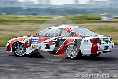 Racing car of E.Satyukov on track in 3-d tour Editorial Image