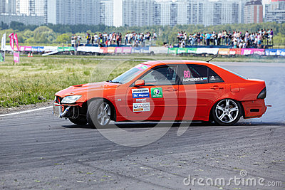 Racing car with pilot D.Kharchenko rides on track Editorial Stock Photo