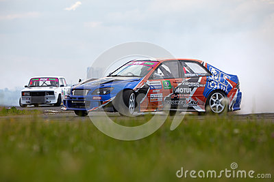 Racing car of V.Pustoshny on track Editorial Photo
