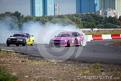 Racing cars of M.Kostyuchik and K.Izotov on track Editorial Stock Image