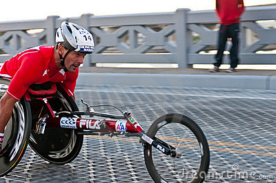 Racing in wheelchair Editorial Stock Image