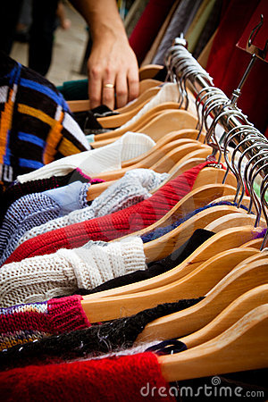 Rack of jumpers at market