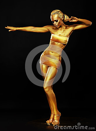 Radiance. Fantasy. Golden Woman Performing in Night Club. Lights