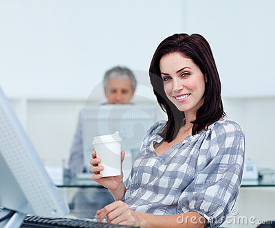 Radiant businesswoman holding a drinking cup
