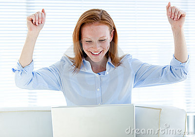 Radiant businesswoman raising her arms