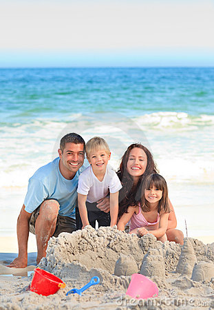 Free Radiant Family At The Beach Royalty Free Stock Photos - 18494238