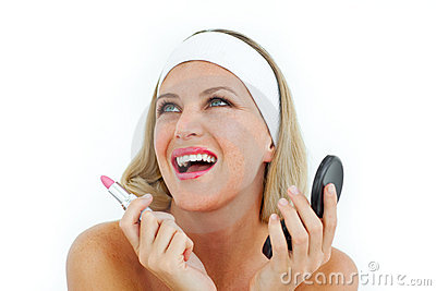 Radiant woman holding a lipstick