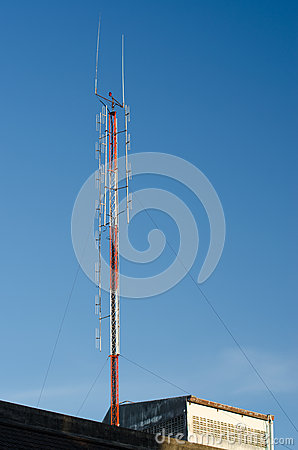A radio communications tower against blue sky