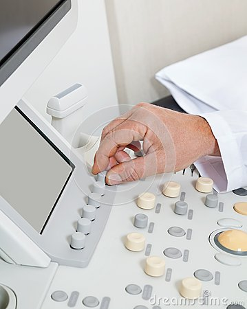 Radiologist Operating Ultrasound Machine
