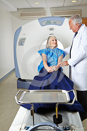 Radiologist talking to senior woman at MRI