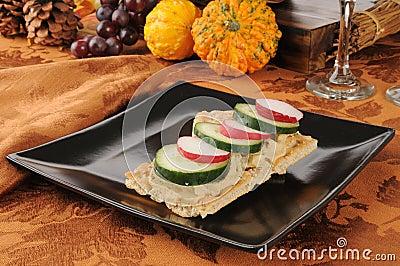 Radishes, cucumbers and hummus on flatbread
