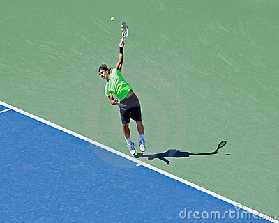 Rafael Nadal of Spain Hits serve during US Open. Editorial Stock Photo