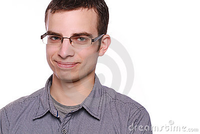 Сraftily smiling young man with glasses