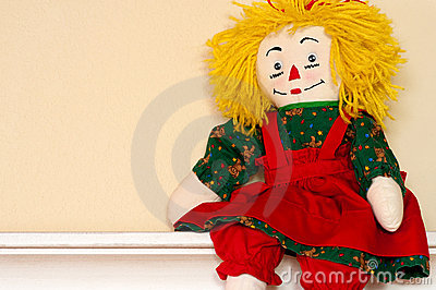 Rag Doll sitting on ledge