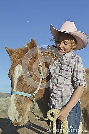 Ragazza e cavallino
