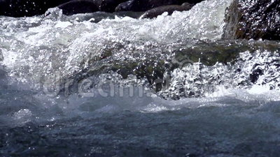 Raging Mountain river. Wildness of clean, clear water in the mountain river. Slow Motion at a rate of 480 fps stock footage