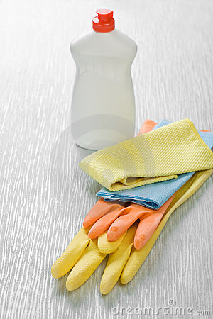 Rags gloves and bottle