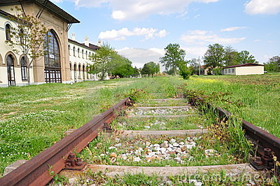 Rail station and railway