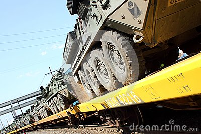 Railroad Convoy of military vehicles. Editorial Stock Photo