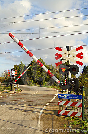 Railroad crossing on a winding road