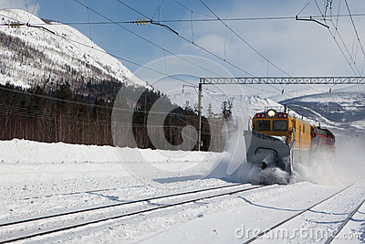 Railroad snowthrower removing snow from railway