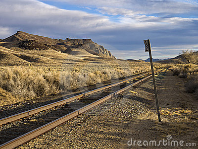 Railroad tracks running through the desert