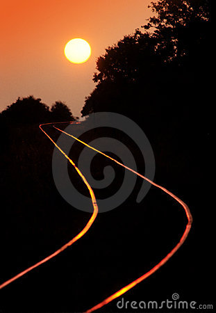 Railroad tracks in sunset