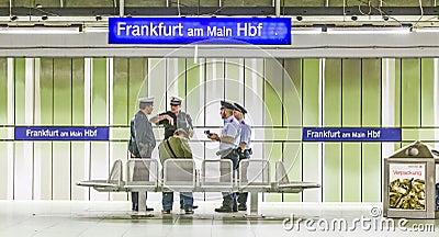 Railway policemen check a passenger for a valid ticket at Frankfurt Main Station