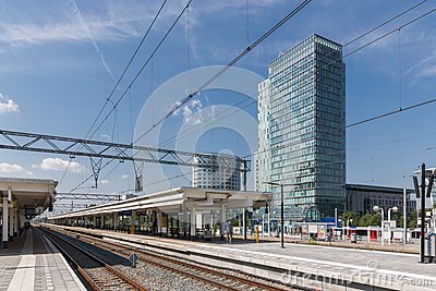 Railway station with office buildings in Amsterdam, the Netherlands