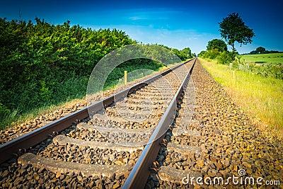 Railway tracks running to the horizon Stock Photo