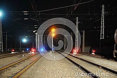 Railway and  train signal at night