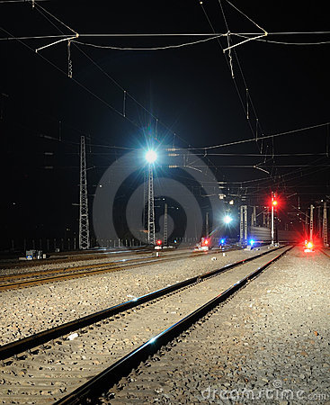 Railway and  train signal at night