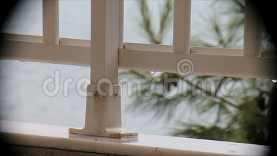 Rain on the balcony overlooking the sea in a vignette stock video footage