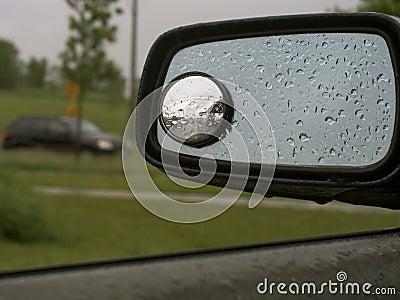 Rain on car mirror 19