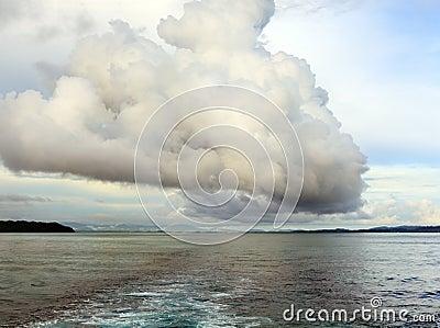 Rain cloud over ocean bay