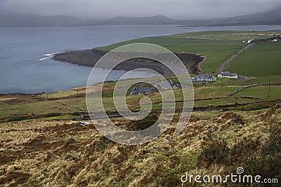 Rain clouds over ireland coast and green landscape.