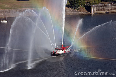 Rainbow across fire boat in Portland, Oregon.