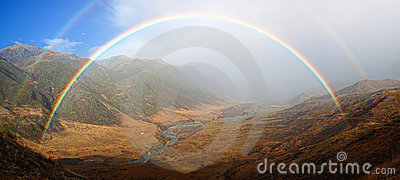 Rainbow in Autumn mountain valley