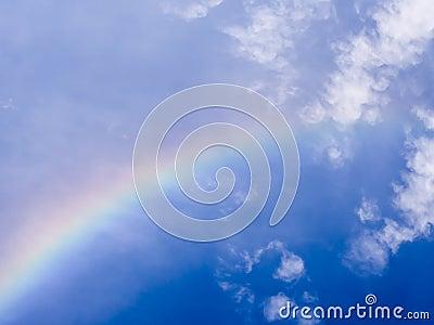 Rainbow in blue sky
