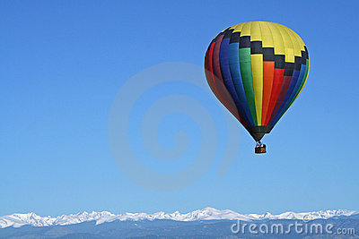 Rainbow Colored Balloon Over the Rockies